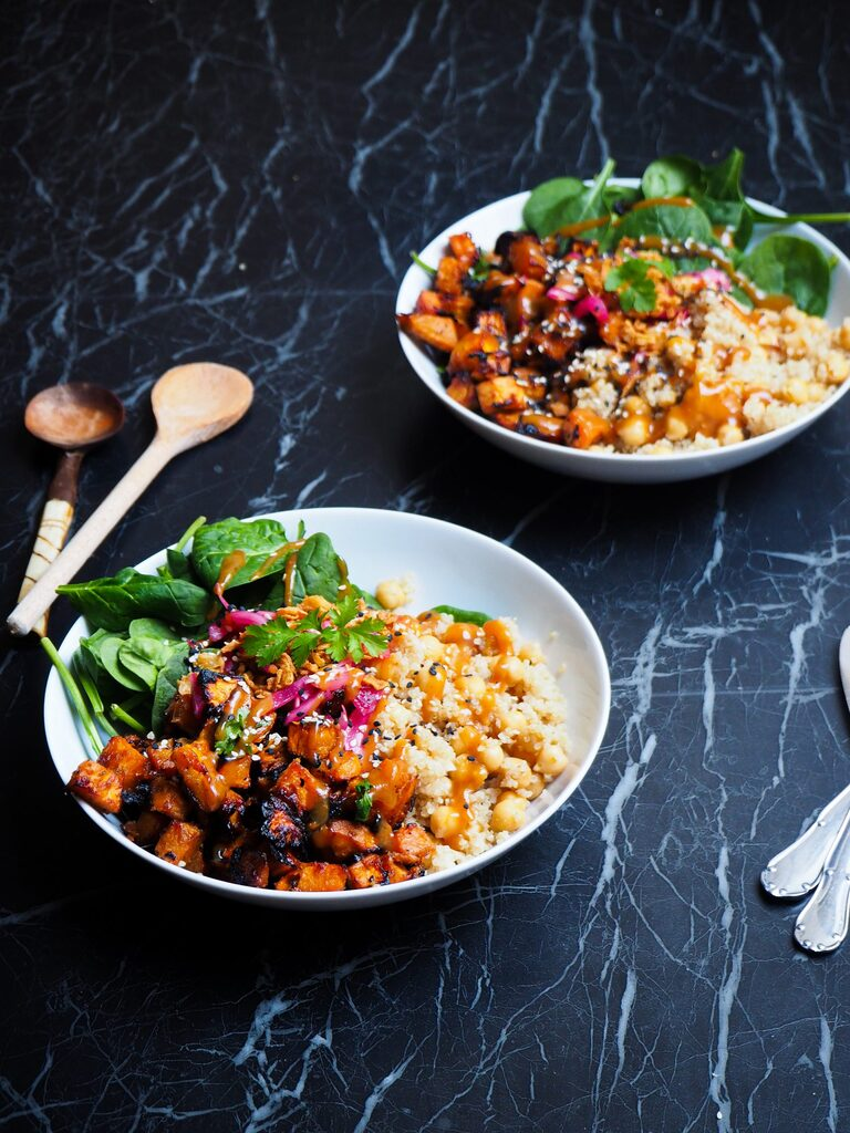 front view of two miso sweet potato and quinoa bowls